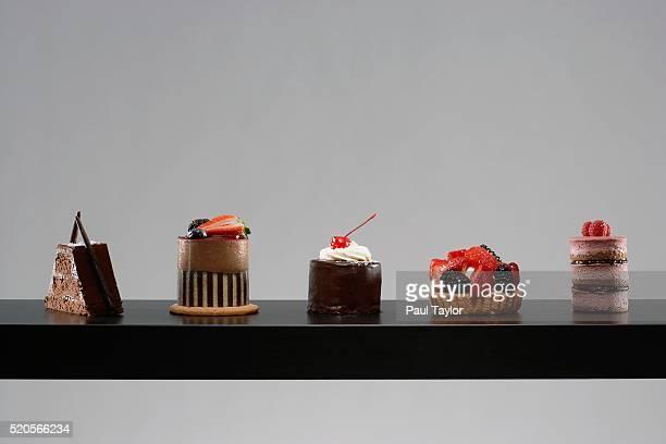 table set with tempting desserts - ケーキ ストックフォトと画像