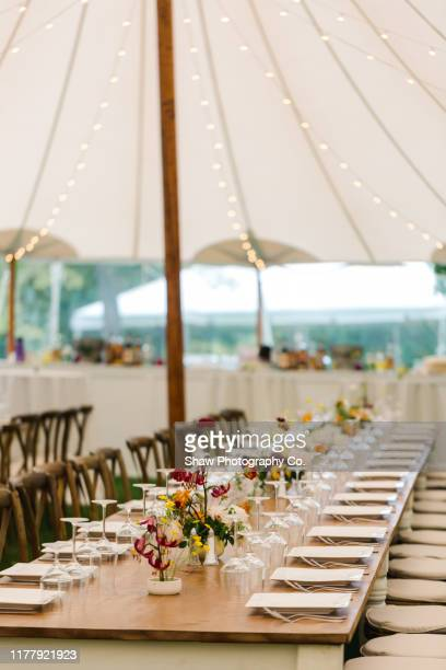 table setting at backyard tent wedding - entertainment tent stock pictures, royalty-free photos & images