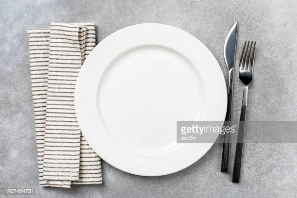 table setting for dinner: empty plate and silverware - plate stock pictures, royalty-free photos & images