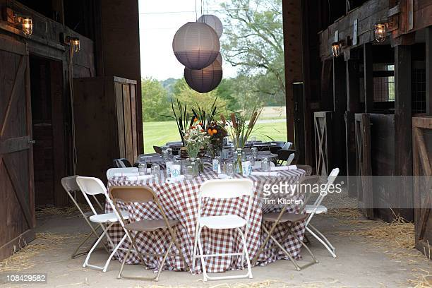 Table setting in barn for country wedding