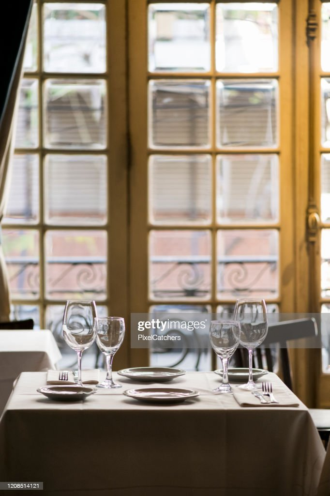 Table Setting In Fancy Restaurant Next To Big Windows High Res Stock Photo Getty Images