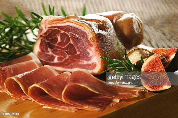 Table setting of a prosciutto ham and slices with figs