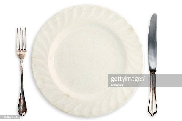 Table Setting; Old Empty Plate and Silverware