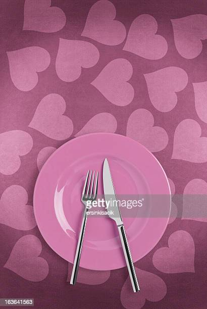 Table setting on heart shape tablecloth