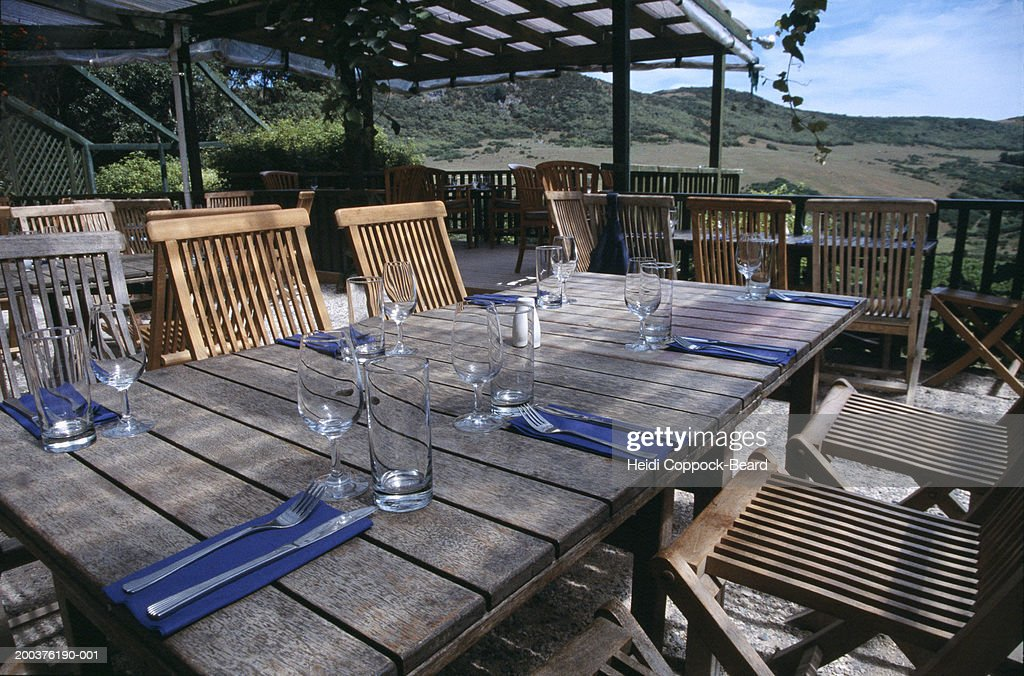 Table setting on porch in vineyard : Stock Photo