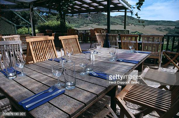 table setting on porch in vineyard - heidi coppock beard bildbanksfoton och bilder