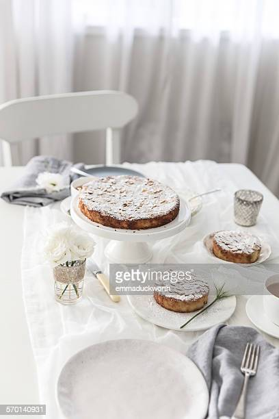 Table setting with afternoon tea and cake