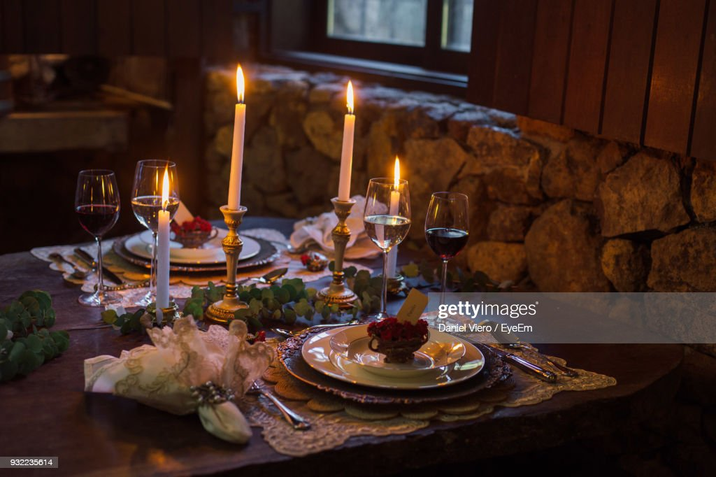 Table Setting With Candles And Wine Glasses Stock Photo Getty Images - Wine glass table setting