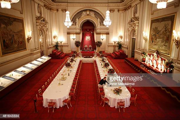 Table settings are laid out in the Palace Ballroom for a State Banquet at The Royal Welcome Summer opening exhibition at Buckingham Palace on July...