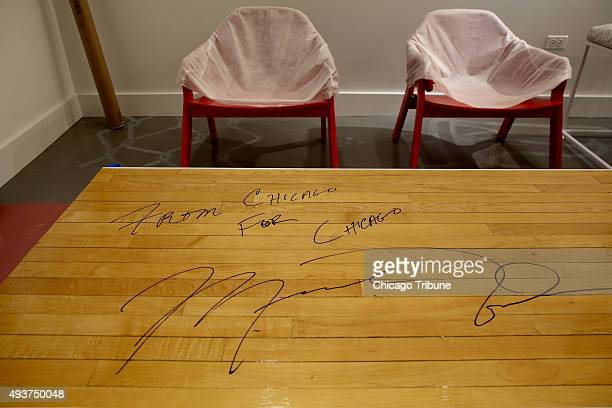 A table signed by Michael Jordan made from wood taken from the floor at the United Center