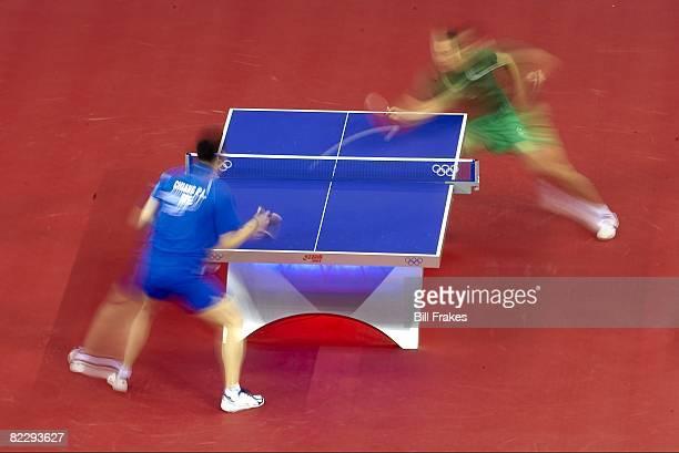 2008 Summer Olympics Blur view of Taiwan PengLung Chiang in action vs Brazil Thiago Monteiro during Men's Team Table Tennis Group C at Peking...