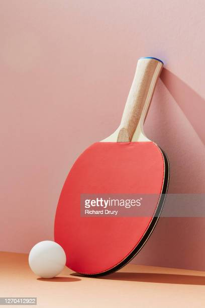table tennis bat and ball leaning against a wall - richard drury stock pictures, royalty-free photos & images