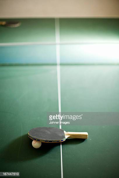 Table tennis bat with ball on table