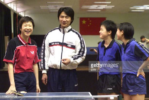 Table tennis player Chen Jing the only athlete ever to win Olympic medals for both Chinese Tapei and the mainland China shares a joke with her coach...