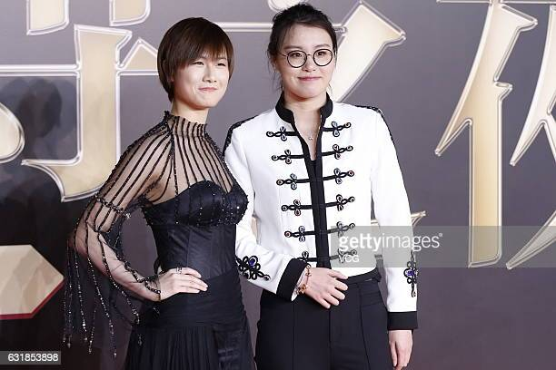 Table tennis player Ding Ning and swimmer Fu Yuanhui arrive at red carpet of 2016 Weibo Awards Ceremony on January 16 2017 in Beijing China
