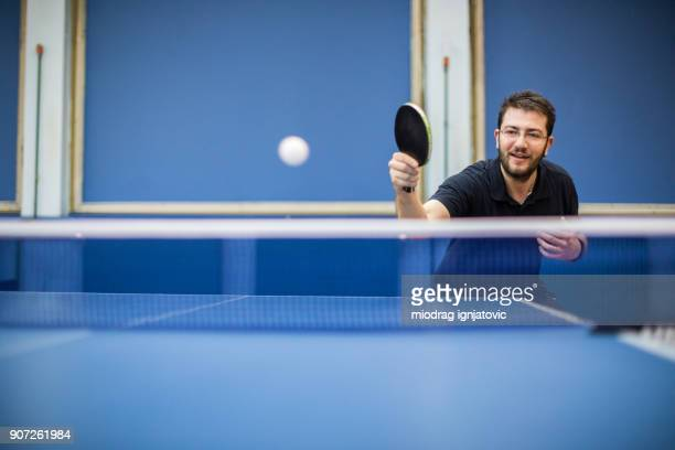 table tennis player playing indoors - table tennis stock pictures, royalty-free photos & images