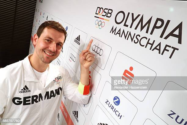 Table tennis player Timo Boll posw for a picture as he is announced as flag bearer for the German Olympic team during a press conference at the...
