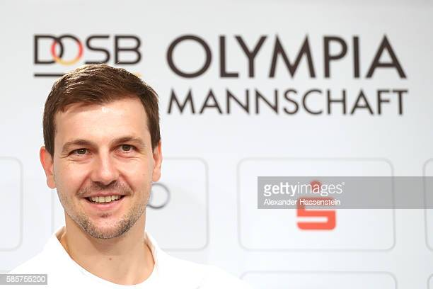 Table tennis player Timo Boll smiles as he is announced as flag bearer for the German Olympic team during a press conference at the 'Deutsche Haus...