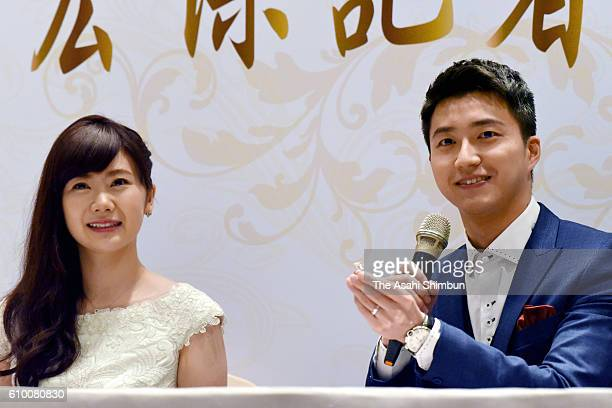Table tennis players Ai Fukuhara and Chiang Hung-Chieh attend a press conference announcing their marriage on September 22, 2016 in Taipei, Taiwan.