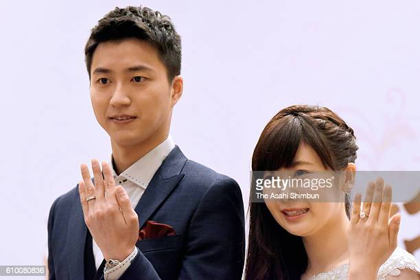 Table tennis players Ai Fukuhara and Chiang HungChieh pose for photographs during a press conference announcing their marriage on September 22 2016...