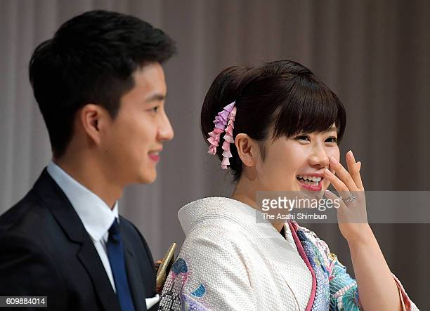Table tennis players Ai Fukuhara and Hung-Chieh Chiang speak during as Chiang holds a ring at the press conference on September 21, 2016 in Tokyo,...