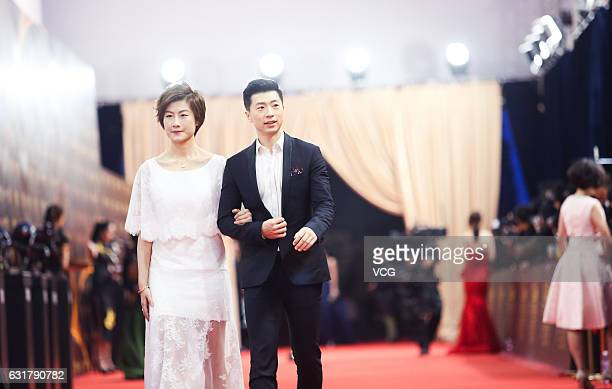 Table tennis players Ma Long and Ding Ning arrive at red carpet of Sports Personality Of The Year 2016 awards ceremony on January 15 2017 in Beijing...