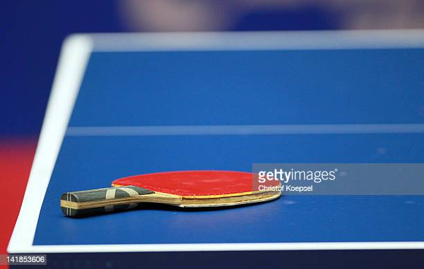 A table tennis racket lies on the table during the LIEBHERR table tennis team world cup 2012 championship division group C women's team match between...