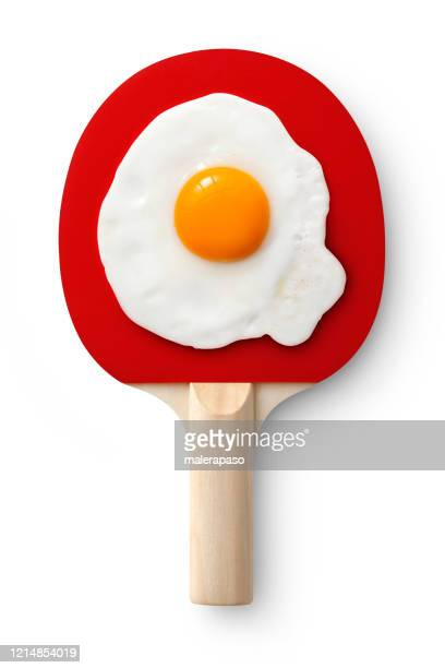 table tennis racket with fried egg. concept photo. - funny ping pong stock pictures, royalty-free photos & images