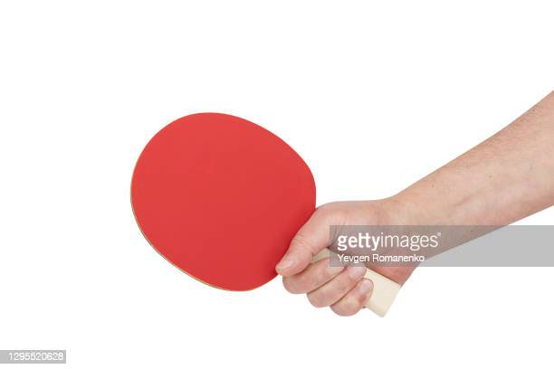 table tennis racket with tennis ball in men's hand isolated on white background - racquet stock pictures, royalty-free photos & images