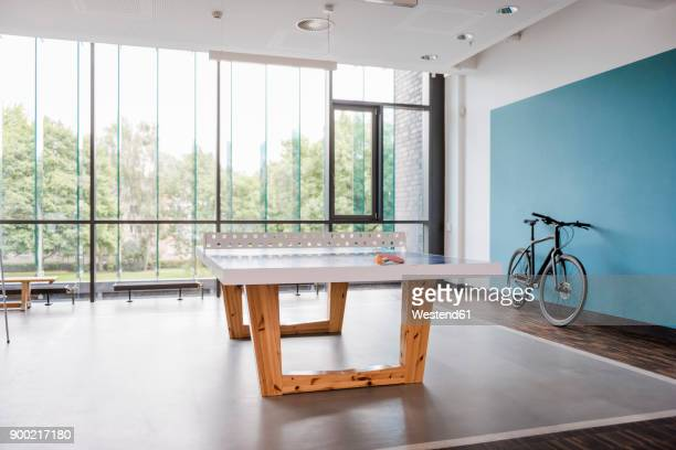 table tennis table and bicycle in break room of modern office - draft sports stock pictures, royalty-free photos & images