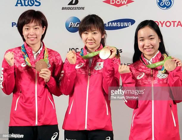 Table Tennis Women's Team bronze medalists Kasumi Ishikawa Ai Fukuhara and Mima Ito of Japan pose for photographs during a Japanese medalists press...