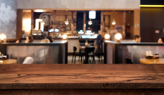 Table top counter with blurred people and restaurant interior background 1077538138