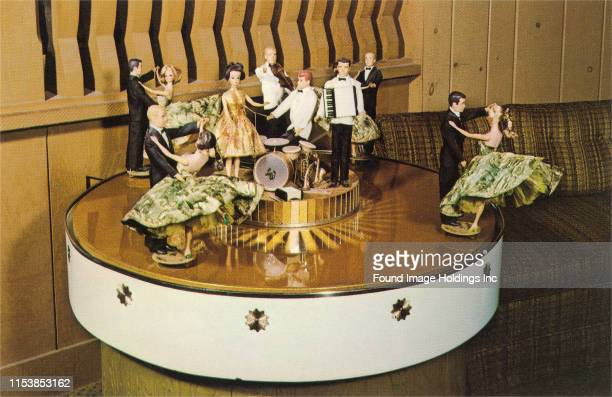 Table top figurines of a dance band and dancers that form part of large music box