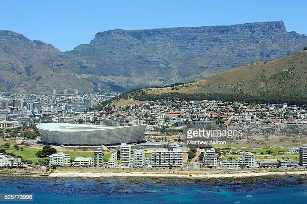 Table Top Mountain looks down upon the Cape Town Stadium Cape Town South Africa It will be one of the host stadiums for the 2010 FIFA World Cup The...
