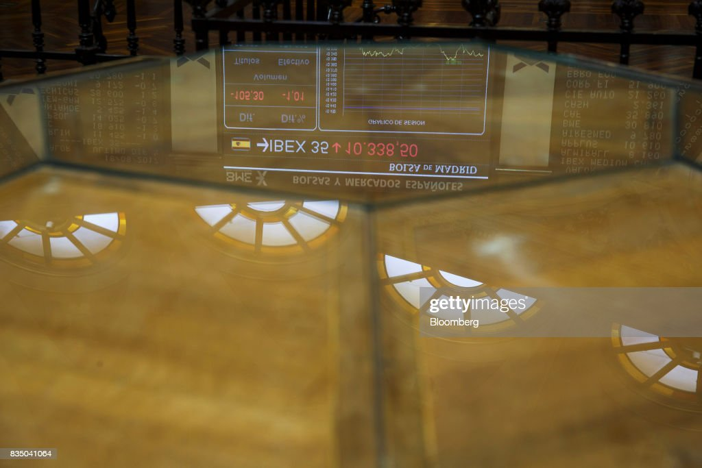 A table top reflects stock price information for the IBEX 35 index inside the Madrid stock exchange, also known as Bolsas y Mercados Espanoles, the day after the Barcelona terror attack in Madrid, Spain, on Friday, Aug. 18, 2017. Terrorists behind the Barcelona attack had planned a devastating assault with explosives and may have rammed pedestrians with vehicles after their initial plan failed, the police chief heading the investigation said on Friday. Photographer: Angel Navarrete/Bloomberg via Getty Images