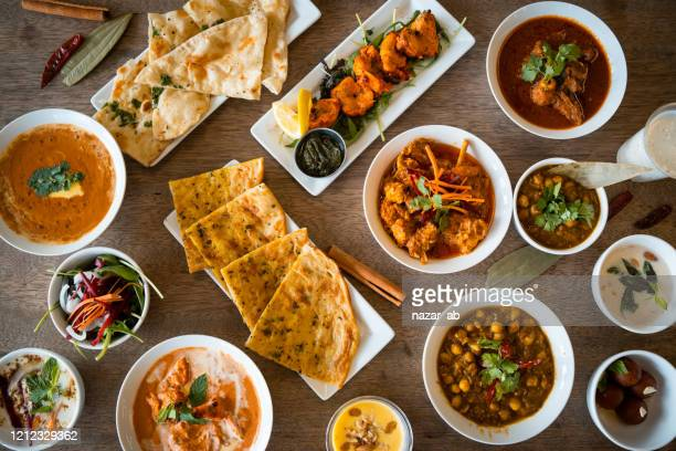 table top view of indian food. - indian food stock pictures, royalty-free photos & images