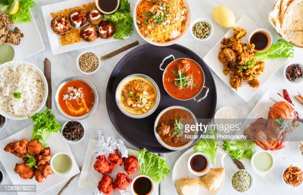table top view of indian food. - tikka masala stock pictures, royalty-free photos & images