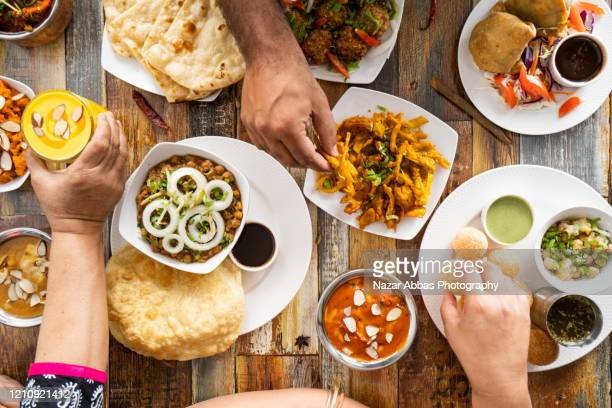 table top view of vegetarian food. - vegetarianism stock pictures, royalty-free photos & images