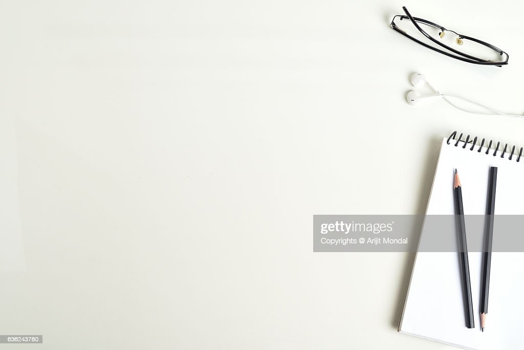 white table top view. Table Top View Of White Office With Spectacle, Notebook, Earphone, Pencils : B