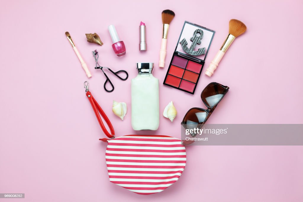 Table top view women fashion & beauty for travel summer holiday background concept.Flat lay accessories objects sun glasses & sun block body lotion on modern rustic pink paper wallpaper and copy space : Stock Photo