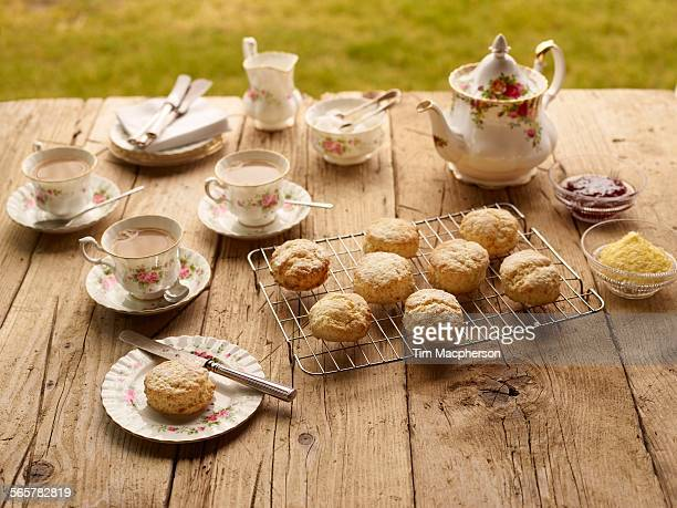 table with afternoon tea of with fresh baked scones with jam and clotted cream - british culture stock pictures, royalty-free photos & images