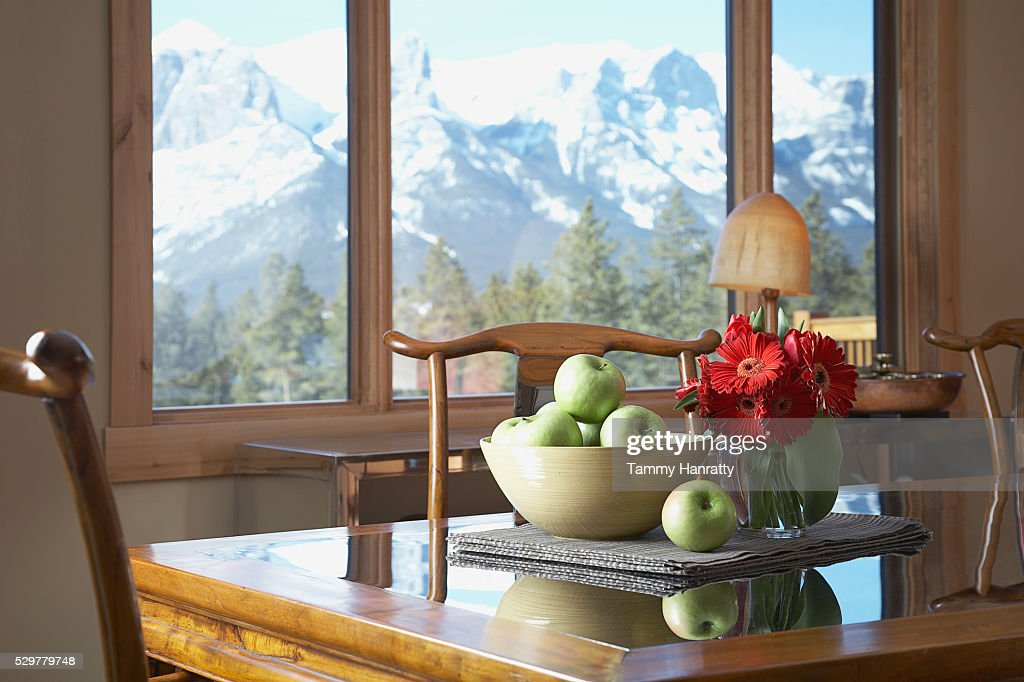 Table with bowl of apples : Bildbanksbilder