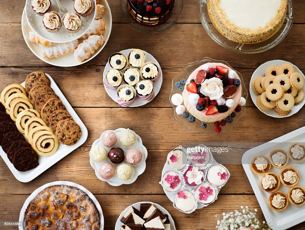Table with cakes, cookies, cupcakes, tarts and cakepops. : Stock Photo