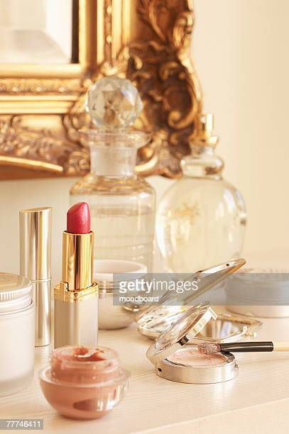 Table With Cosmetics and Wall Mirror