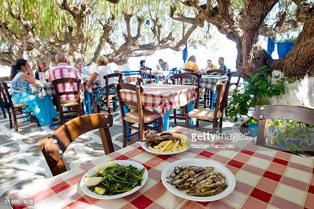 A table with greek gourmet in a typical seafood taverna on August 24 2010 in Heraklion Greece