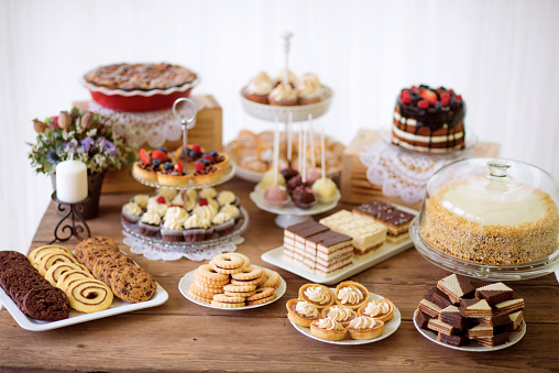 Table with various cookies, tarts, cakes, cupcakes and cakepops 623709028