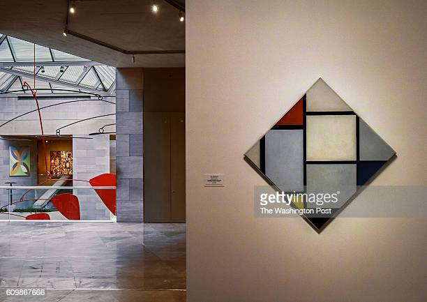 'Tableau No IV Lozenge composition with Red Gray Blue Yellow and Black' by Piet Mondrian right in one of the new galleries with a view into the main...