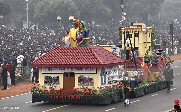 A tableau representing Ministry of Housing and Urban Poverty Alleviation rolls down during the celebration of the 68th Republic Day at Rajpath on...