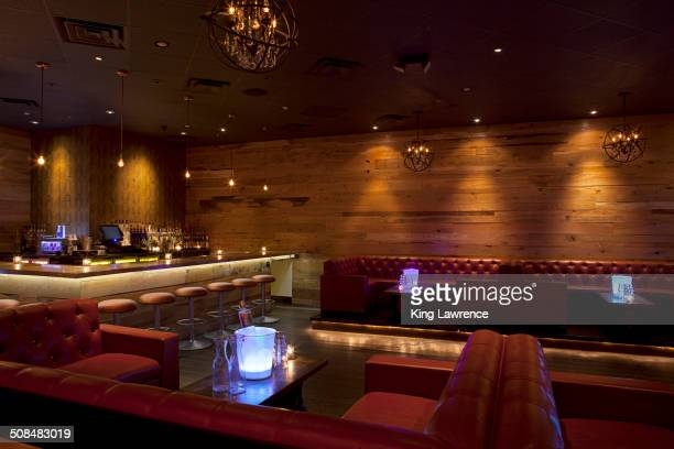 Tables and booths in empty nightclub