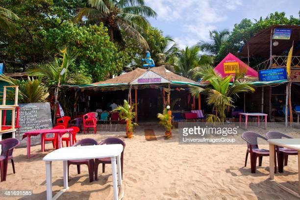 Tables and chairs at a restaurant German Bakery Arambol Beach Arambol North Goa Goa India